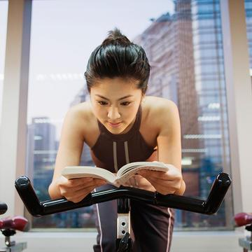 woman-reading-on-spin-bike_0.jpg